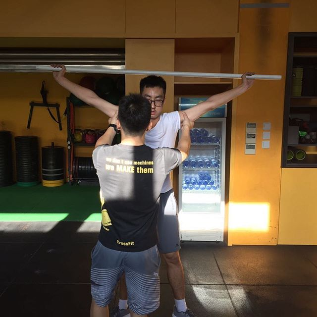 External Rotation through the shoulder. If you sit in your office chair for long hours, chances are, you need more it! Dont worry, when you can squat with your arms in that position then you're cured 😉 . . Inspired Through Fitness . . . #crossfit #crossfitmacau #crossfitmacao #macaucrossfit #macaocrossfit #gym #crossfitters #lifting #wod #weight #workout #crazy #muscles #hardwork #fitfam #igfitness #beautiful #health #enjoy #love #nutrition #hardwork #live #addicted  #fit #fitness #family #fitfam #macau #community