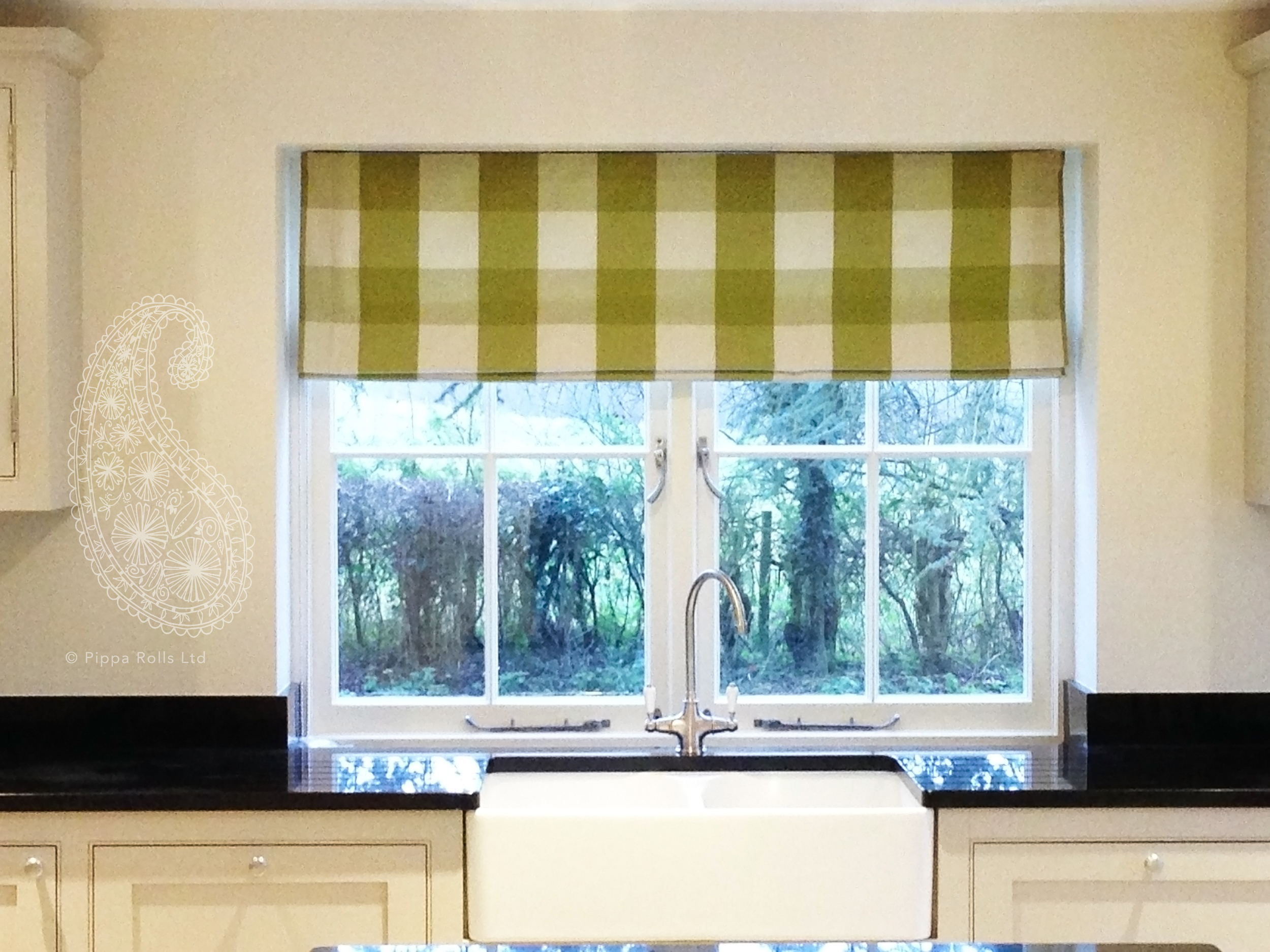 Inside Reveal Green Roman Blind Pippa Rolls Limited jpeg.jpg
