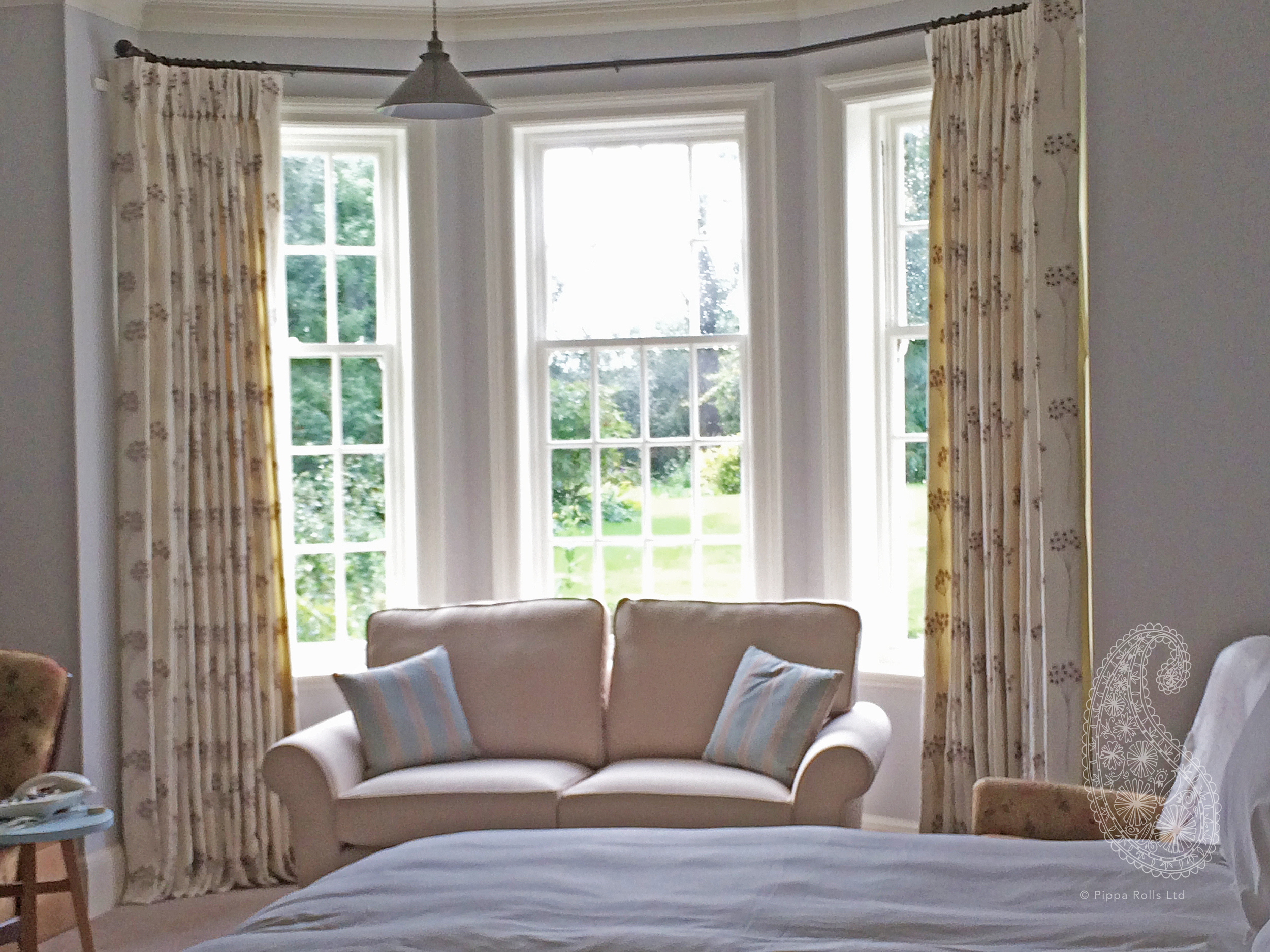 Bay window curtains hung on a bespoke pole by Pippa Rolls Limited jpeg.jpg