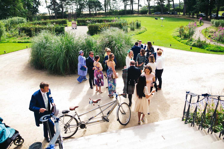 newton-hall-northumberland-wedding-cycling-bike-theme-beach-0031.jpg