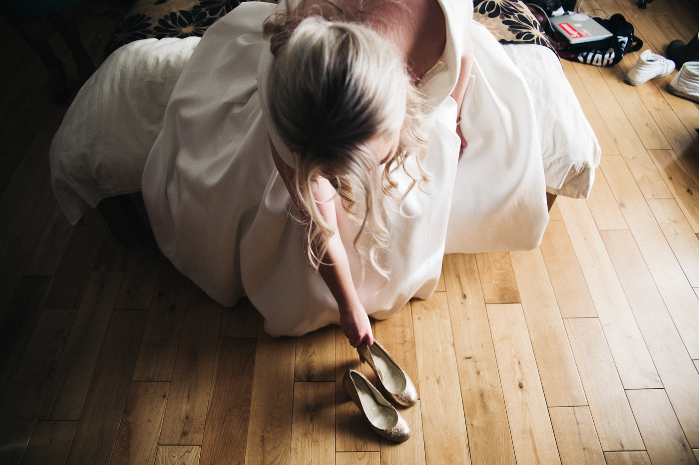 a bride reaches down for her shoe. creative wedding photography north yorkshire teesside north east + stop motion wedding films uk
