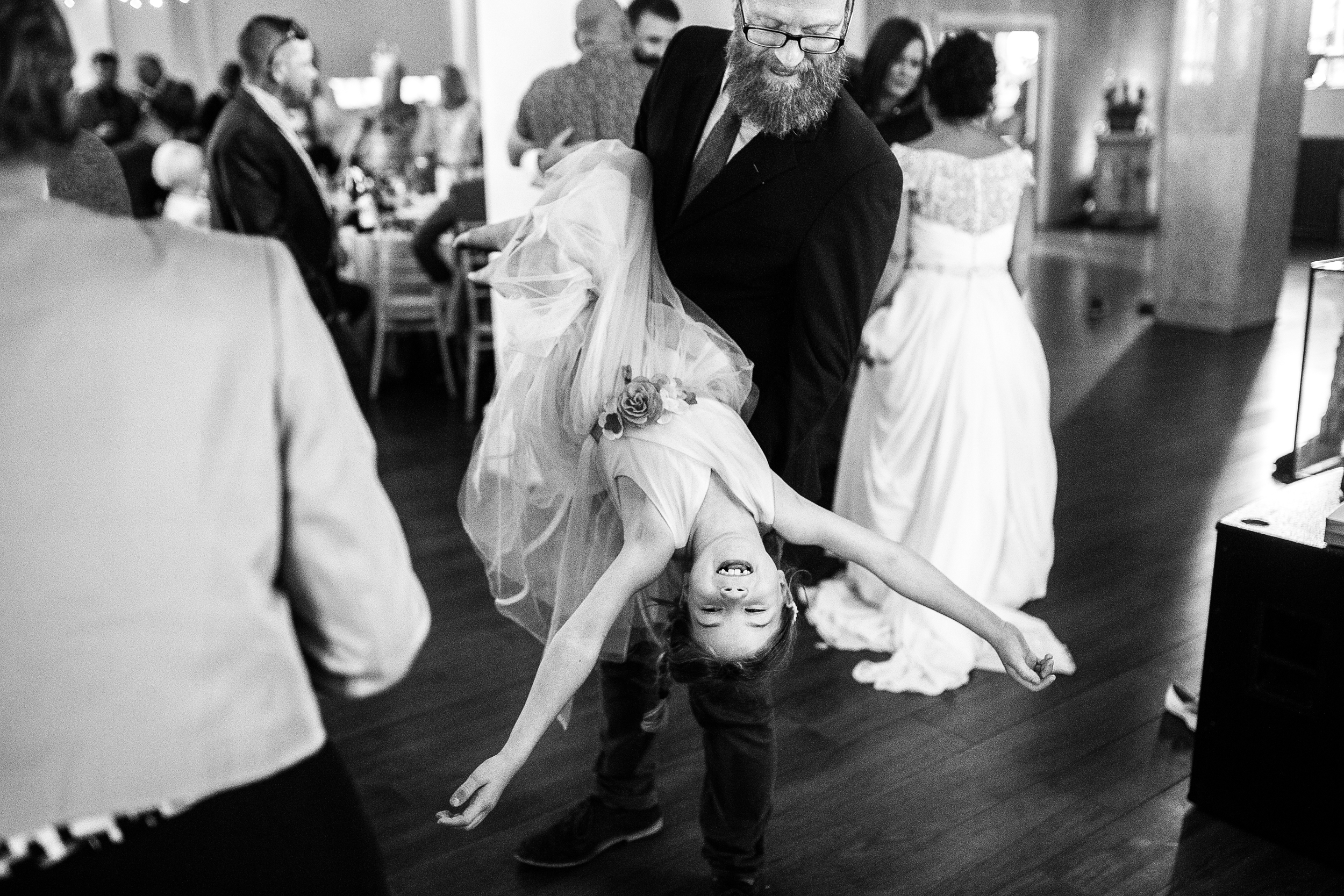 a girl is held upside down on the dancefloor. creative wedding photography north yorkshire teesside north east + stop motion wedding films uk