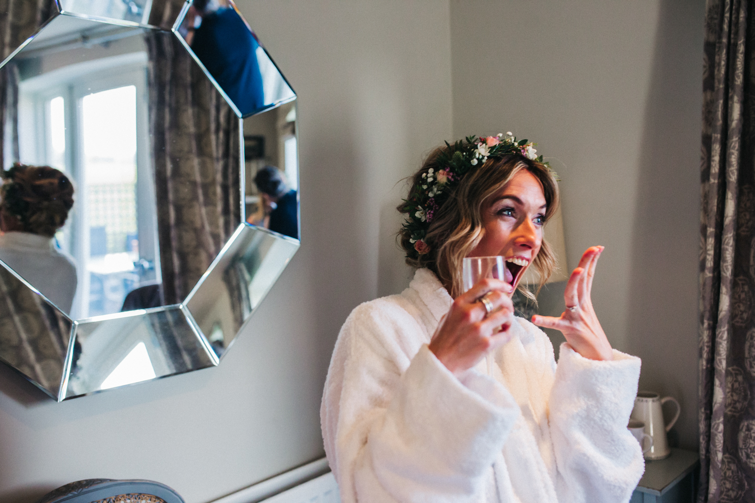 a bride looks excited, joyful and surprised. wedding at priory wedding barn in wetherby, stop motion wedding films videos uk