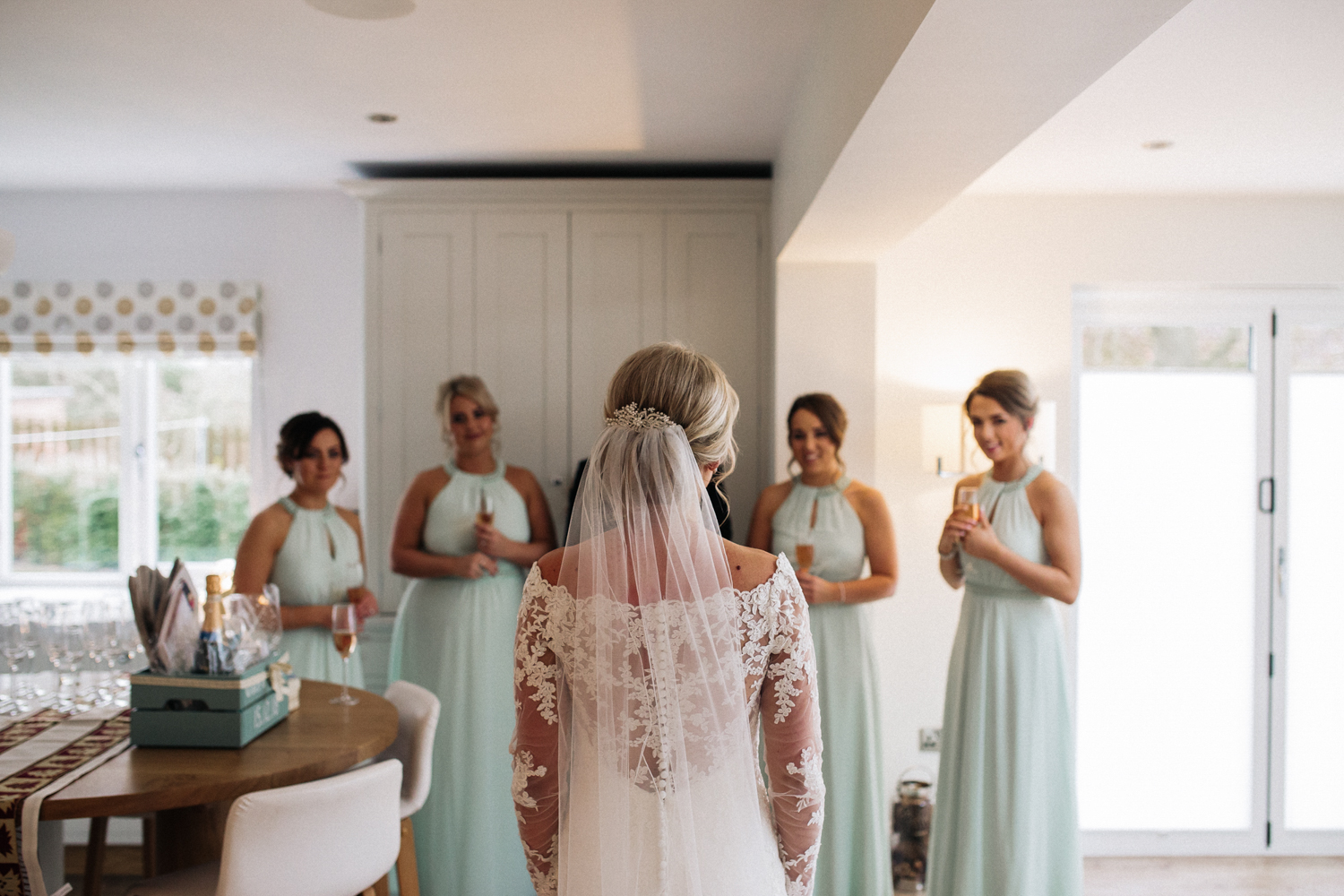 a bride stands in her dress in front of her bridesmaids. wedding at rudby hall north yorkshire venue. stop motion wedding films videos uk