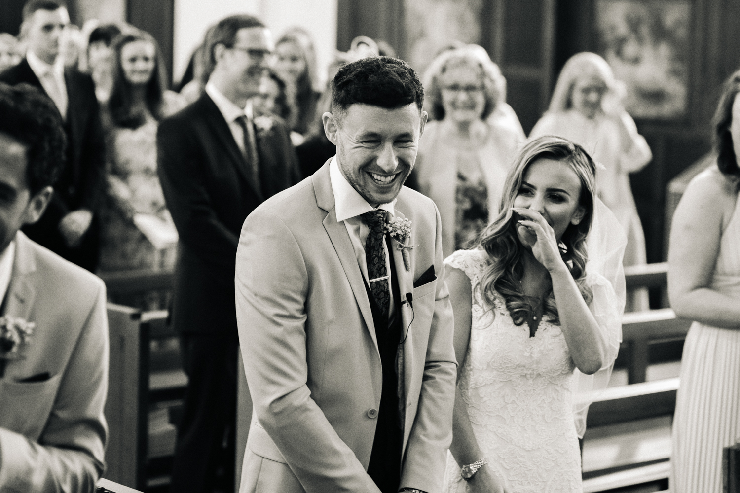 a bride and groom laugh saying their vows in church. worsall village hall wedding north yorkshire. stop motion wedding films videos uk