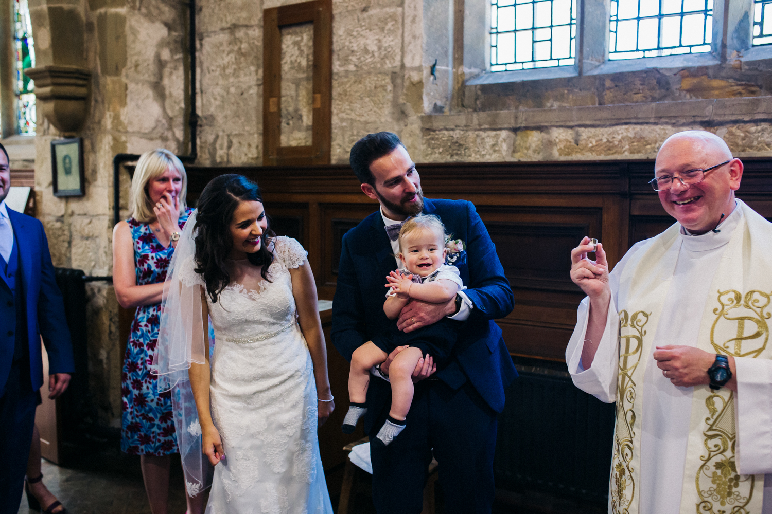 abride and groom have their baby christened. village hall wedding venue north yorkshire northallerton. stop motion wedding films videos uk