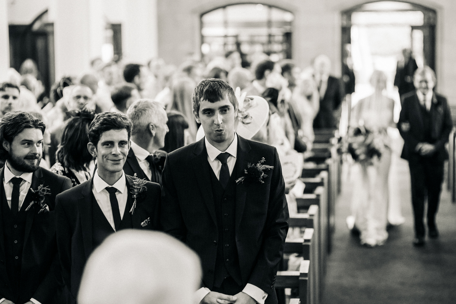 a groom looks overwhelmed as his future wife walks down the aisle. ormesby hall wedding middlesbrough. stop motion wedding films videos uk
