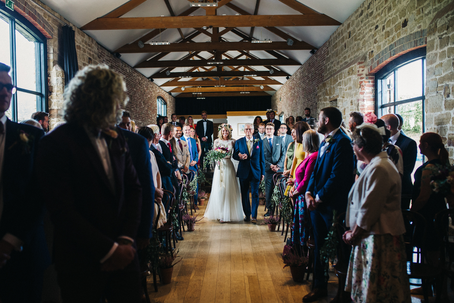 a bride walks down the aisle . hendall manor barn brighton. stop motion wedding films videos uk