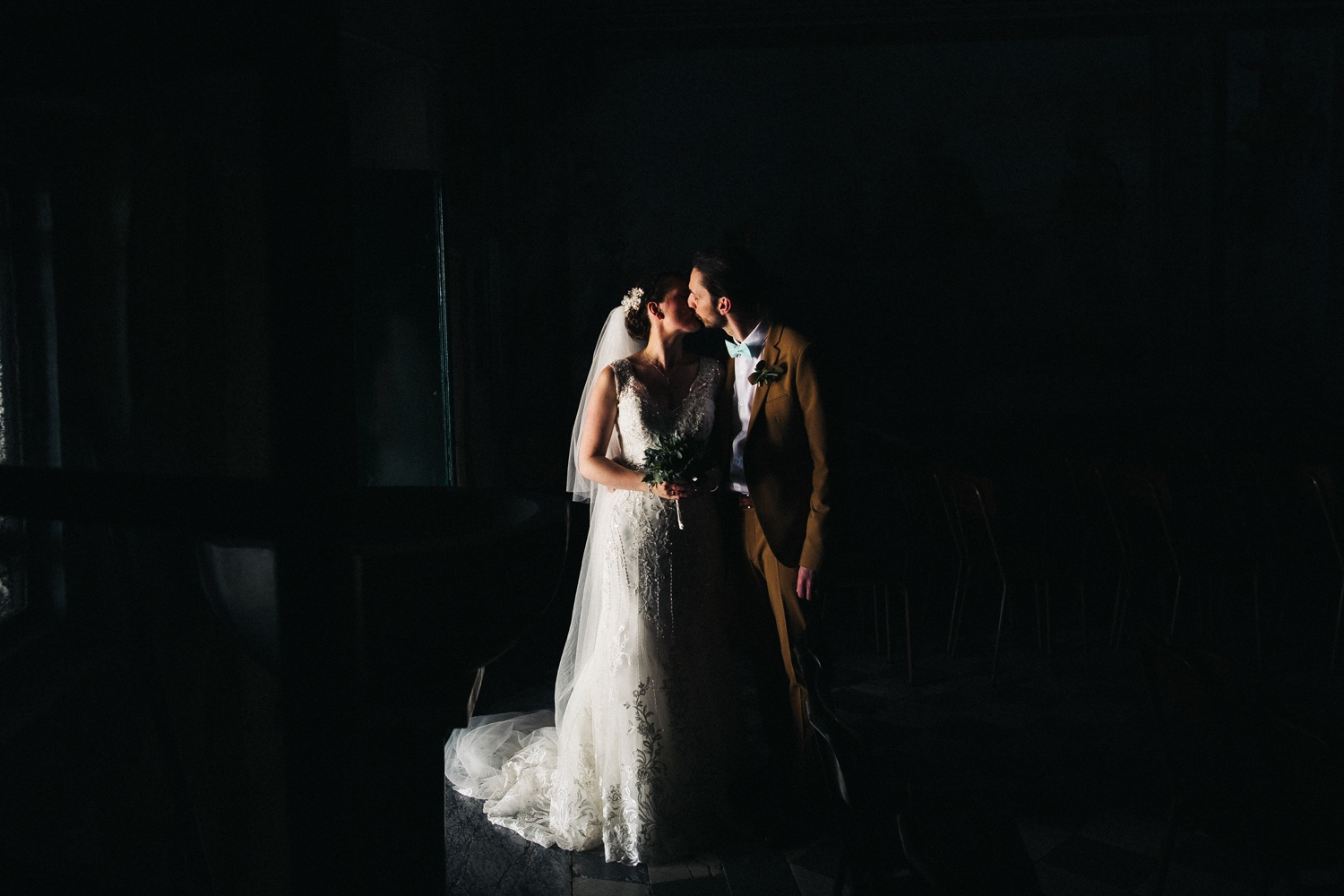 a man and woman kissing in the darkness. destination wedding italy, chiavari, hotel monte rosa. stop motion wedding films videos uk
