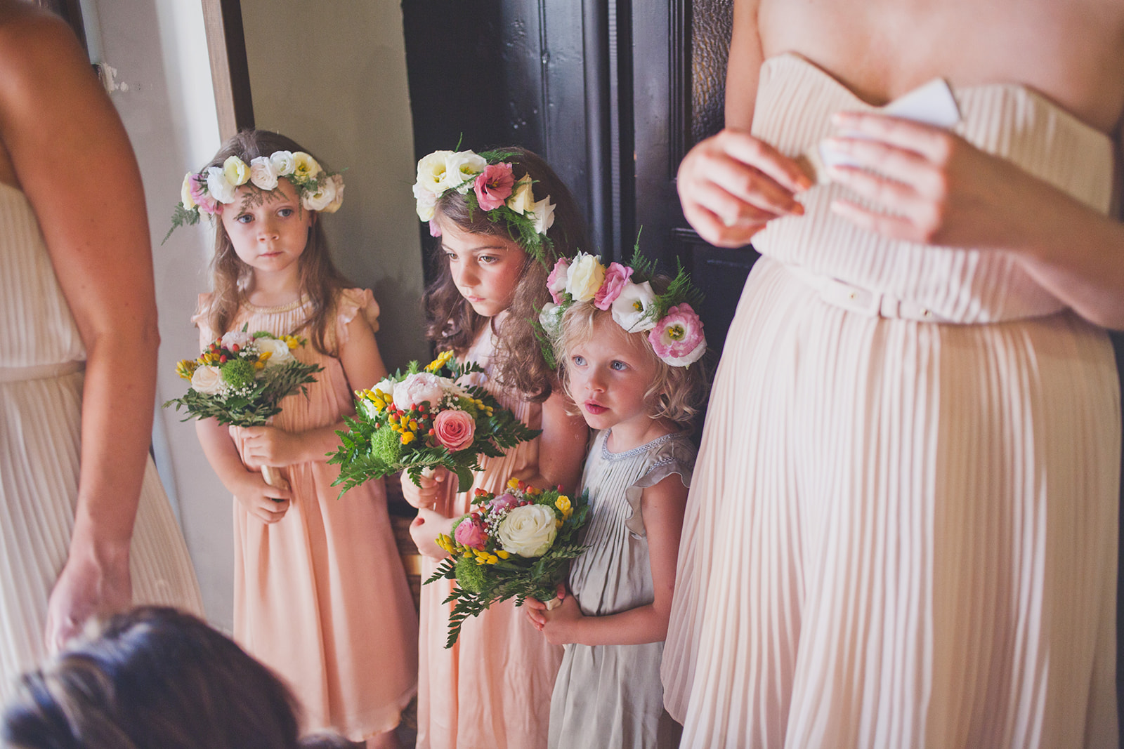 flowergirls stand waiting to go into church. destination wedding photography in italy, rome. stop motion wedding films