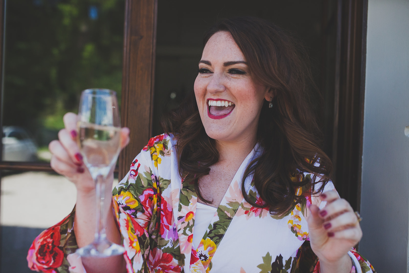 a bride looks happy and holds a glass of champagne. destination creative wedding photography italy. stop motion wedding films uk