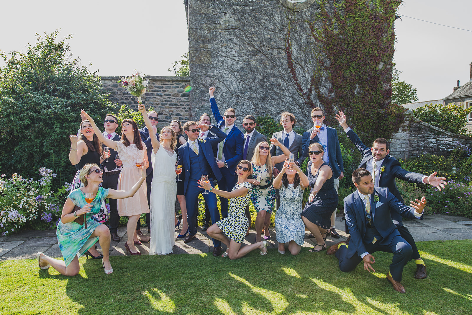 a fun group shot of the bride and groom and their friends. underlay grange marquee wedding lake district. stop motion wedding films uk