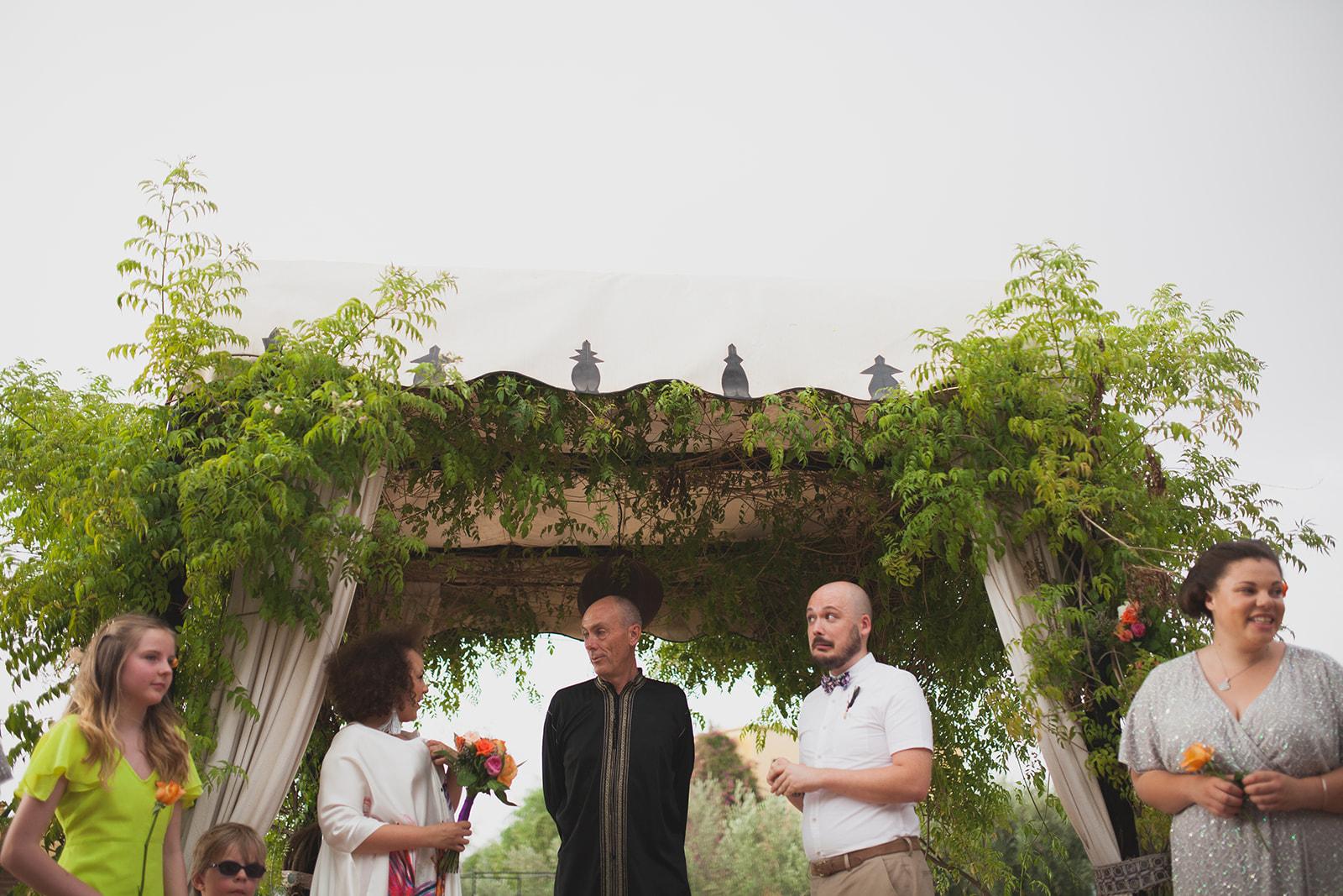 a groom looks nervous during the wedding ceremony. fawakay villas marrakech wedding morrocco wedding photography. stop motion wedding films uk
