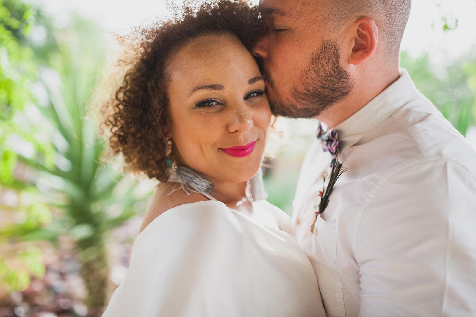 a groom kisses a bride, close shot. fawakay villas marrakech wedding morrocco wedding photography. stop motion wedding films uk