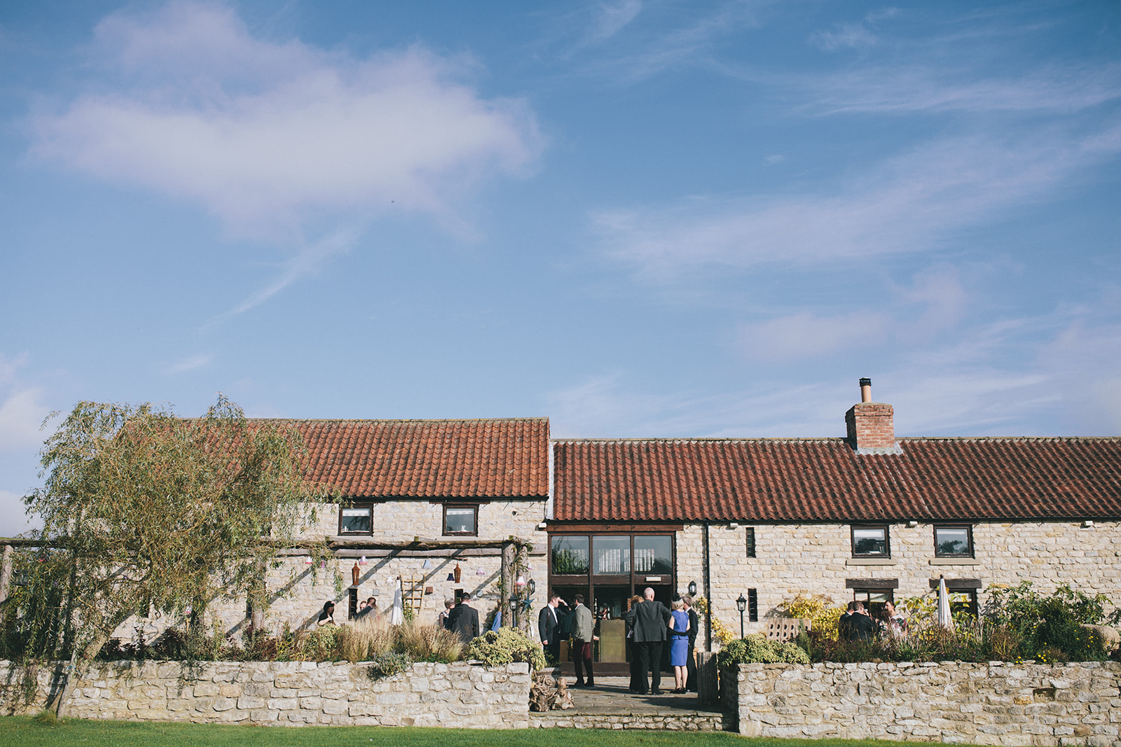 a wide shot of the barn-type wedding venue. star inn at harome near helmsley, north yorkshire wedding photographer. stop motion wedding films uk.