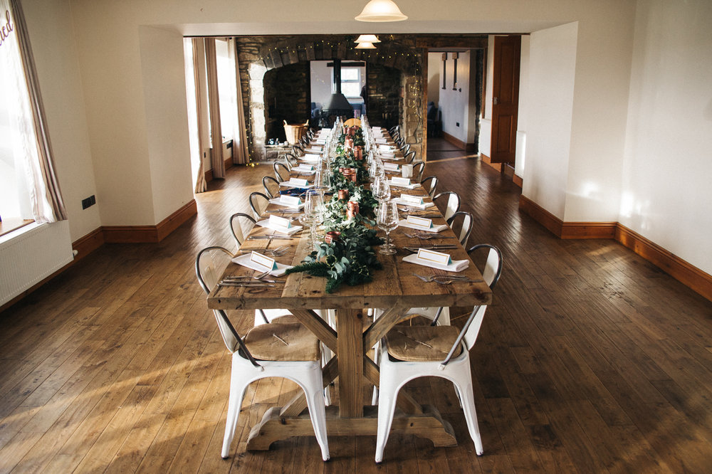 a long table is set with wintery decorations. intimate winter wedding north east wedding photographer, stop motion wedding films uk