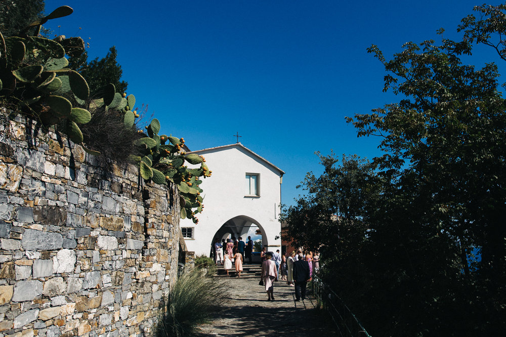 a shot of a white church against a bright bluke sky. destination wedding hotel monte rosa chiavari italy. stop motion wedding films uk