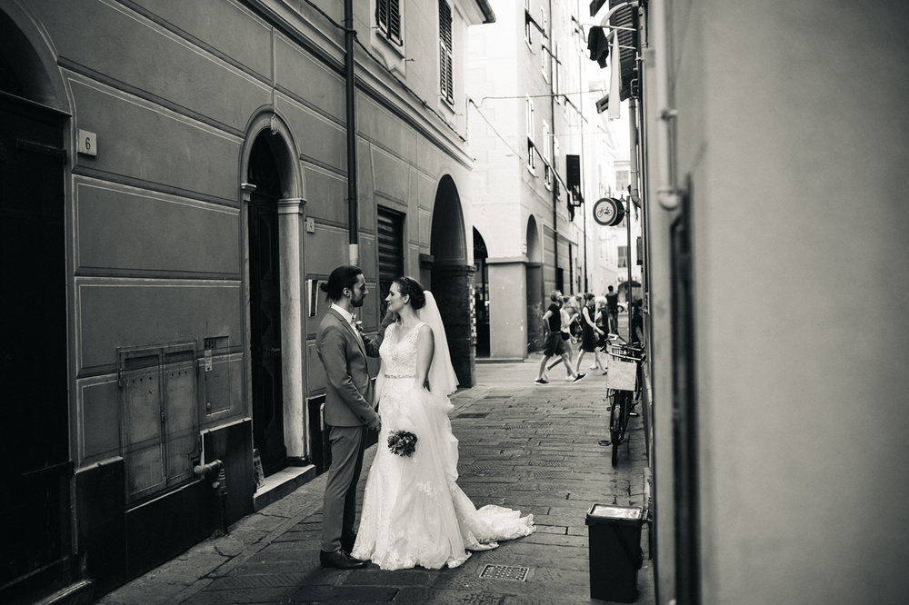 a black and white shot of a couple standing in an italian street. destination wedding hotel monte rosa chiavari italy. stop motion wedding films uk