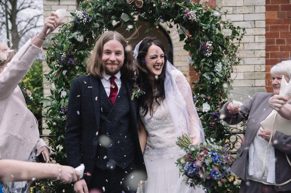 a bride and groom smile - confetti shot. eshott hall wedding newcastle northumberland wedding photography. stop motion wedding films uk