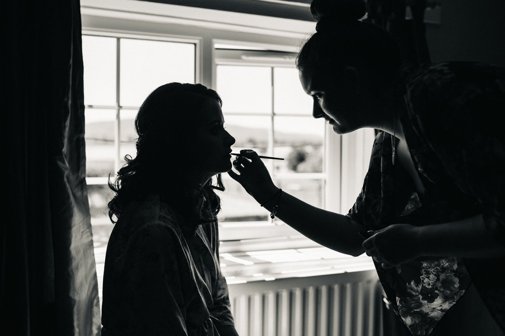 a bride has her make up applied. diy village hall wedding venues north yorkshire northallerton. stop motion wedding films uk