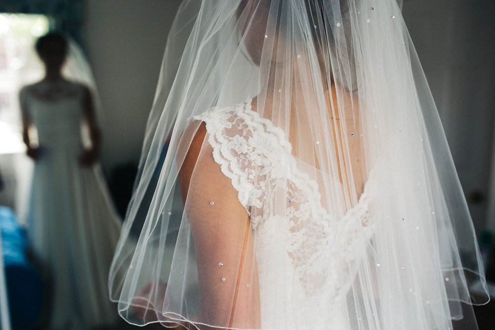 a detail shot of a bride's lace dress. aldby park wedding york north yorkshire teesside photography stop motion wedding films uk