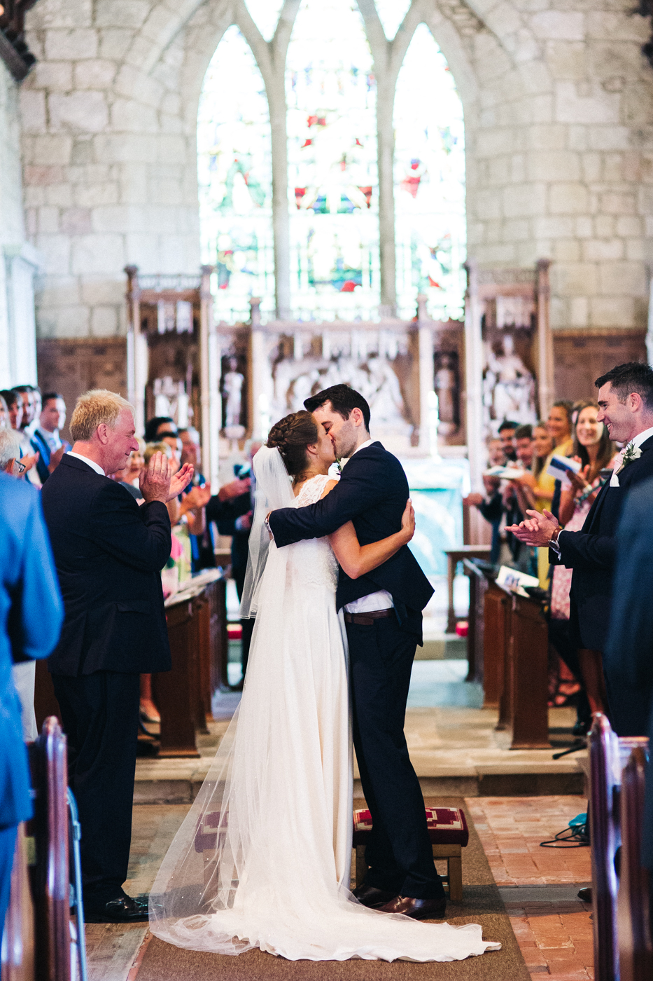 a bride and groom kiss at the end of the aisle. aldby park wedding york north yorkshire teesside photography stop motion wedding films uk
