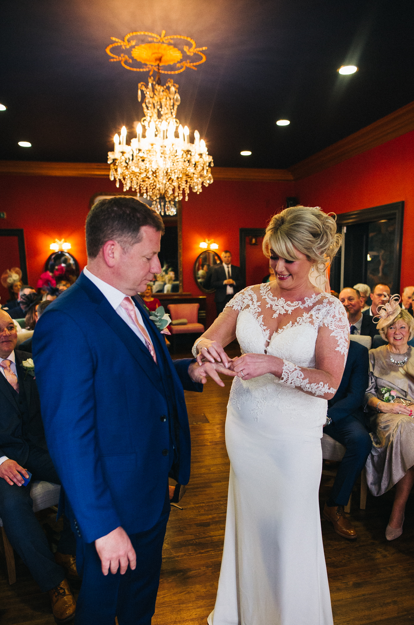 the bride puts the ring on her husband's finger. cleveland tontine wedding teesside north yorkshire - relaxed and creative wedding photographer