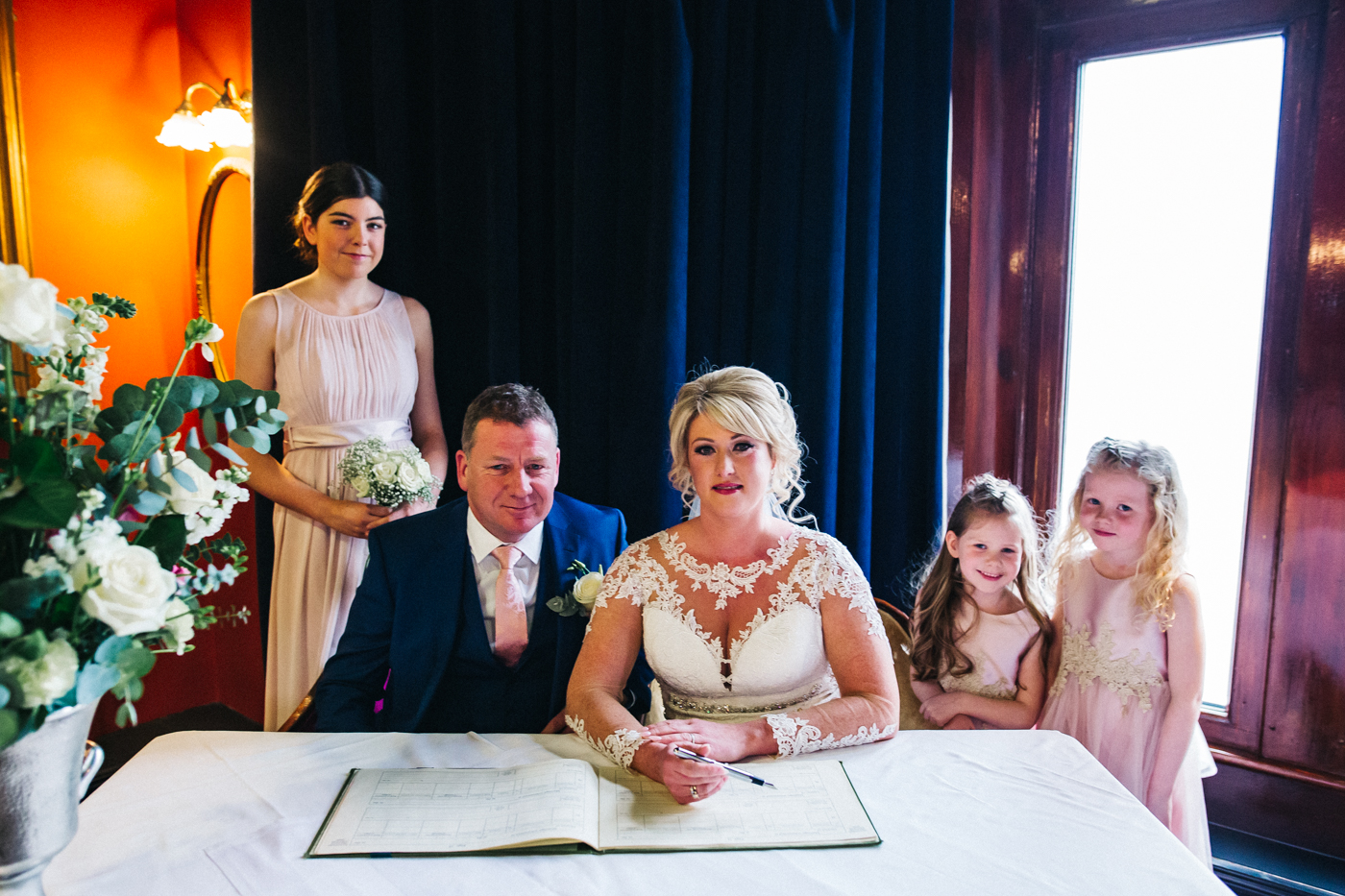 a family shot as the bride and groom sign the register. cleveland tontine wedding teesside north yorkshire - relaxed and creative wedding photographer