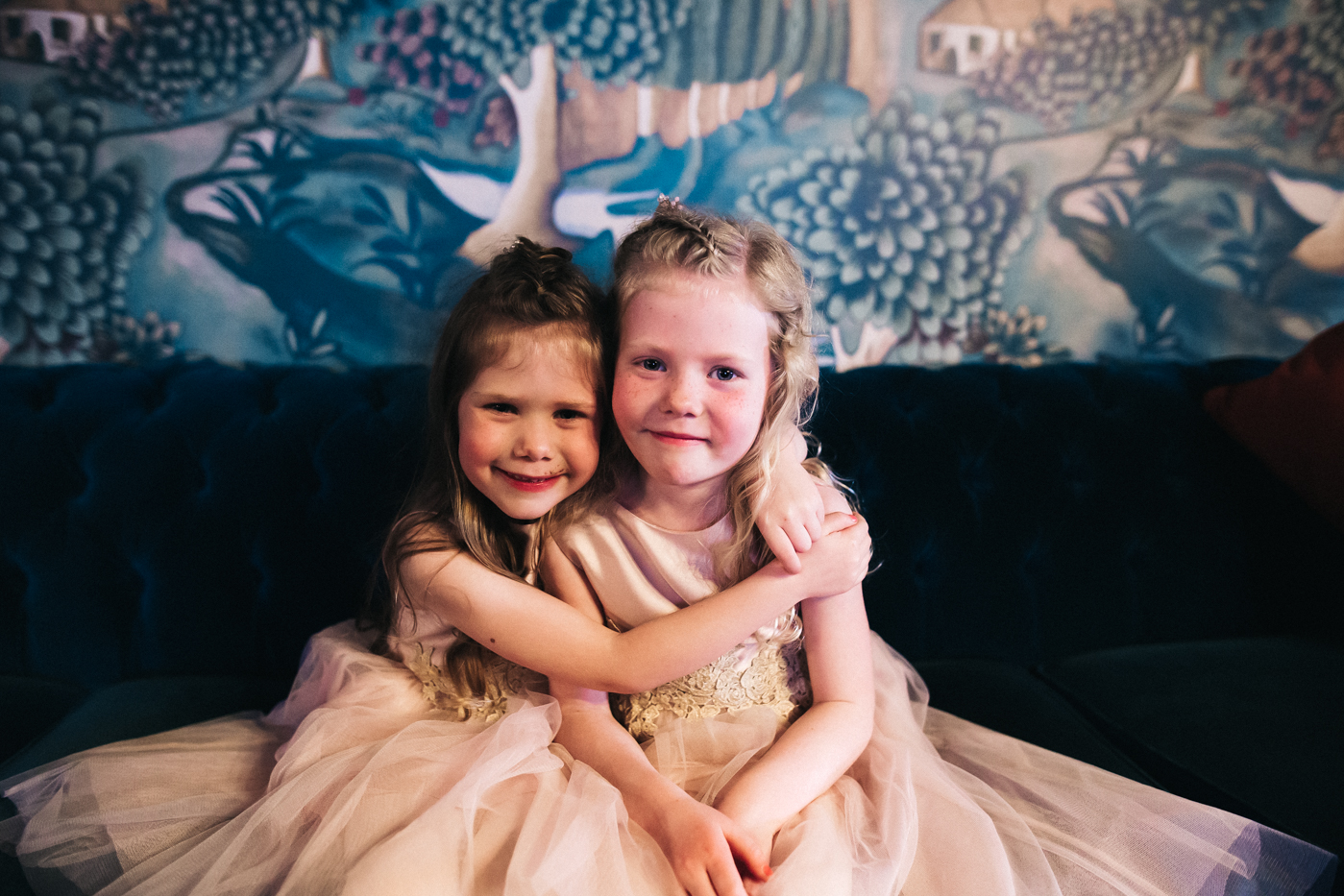two young girls cuddle. cleveland tontine wedding teesside north yorkshire - relaxed and creative wedding photographer