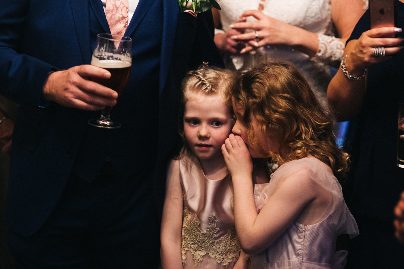 one young girls whispers to another. cleveland tontine wedding teesside north yorkshire - relaxed and creative wedding photographer