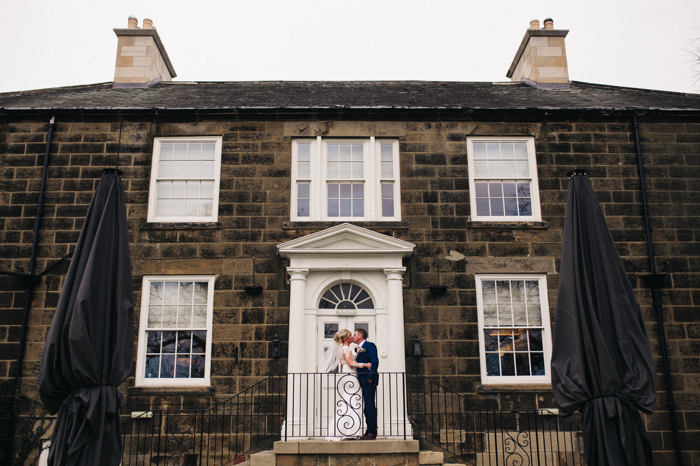 a shot of the bride and groom standing on the steps outside the venue. cleveland tontine wedding teesside north yorkshire - relaxed and creative wedding photographer