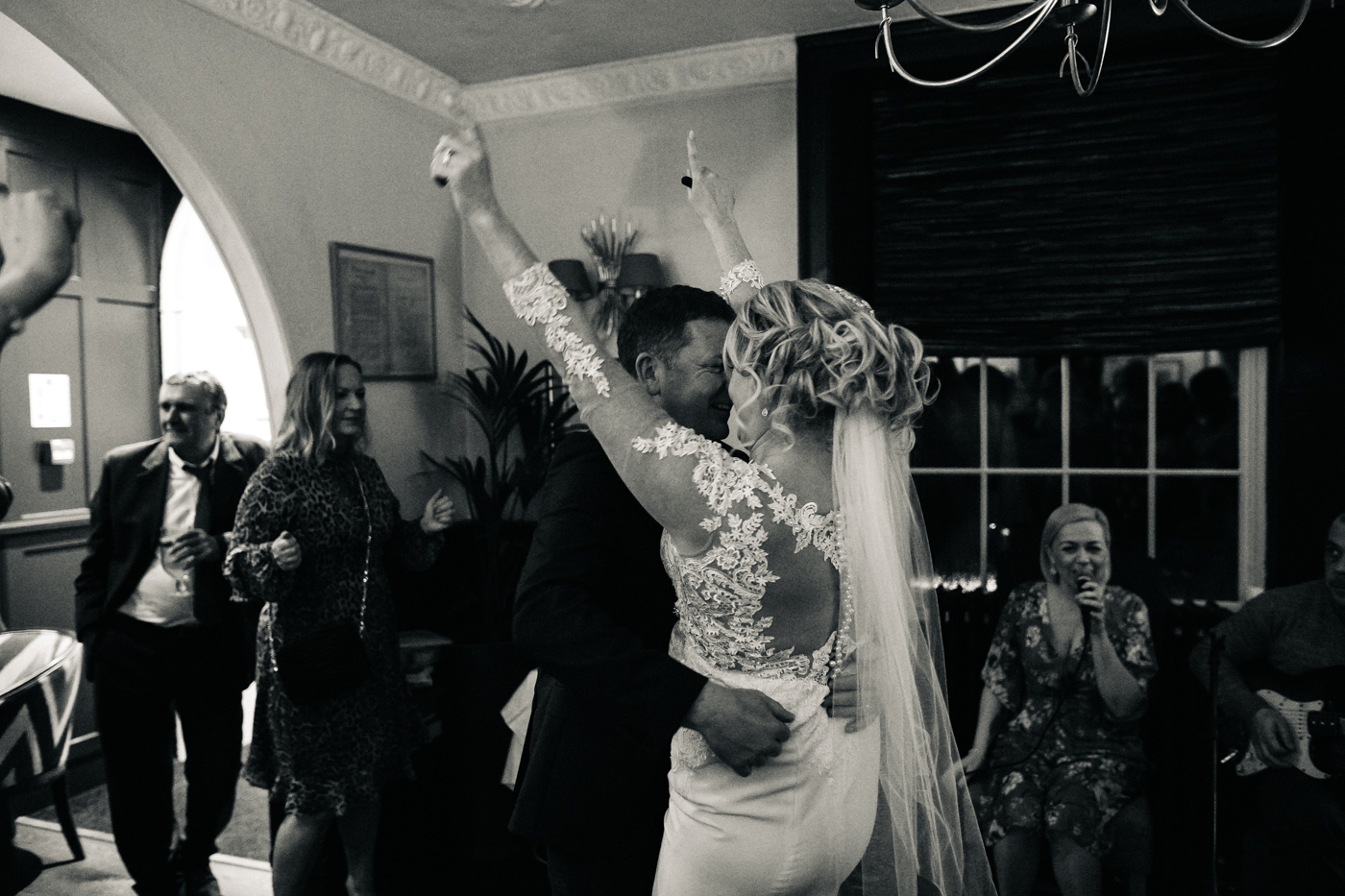 the bride and groom dance, her arms are in the air. cleveland tontine wedding teesside north yorkshire - relaxed and creative wedding photographer