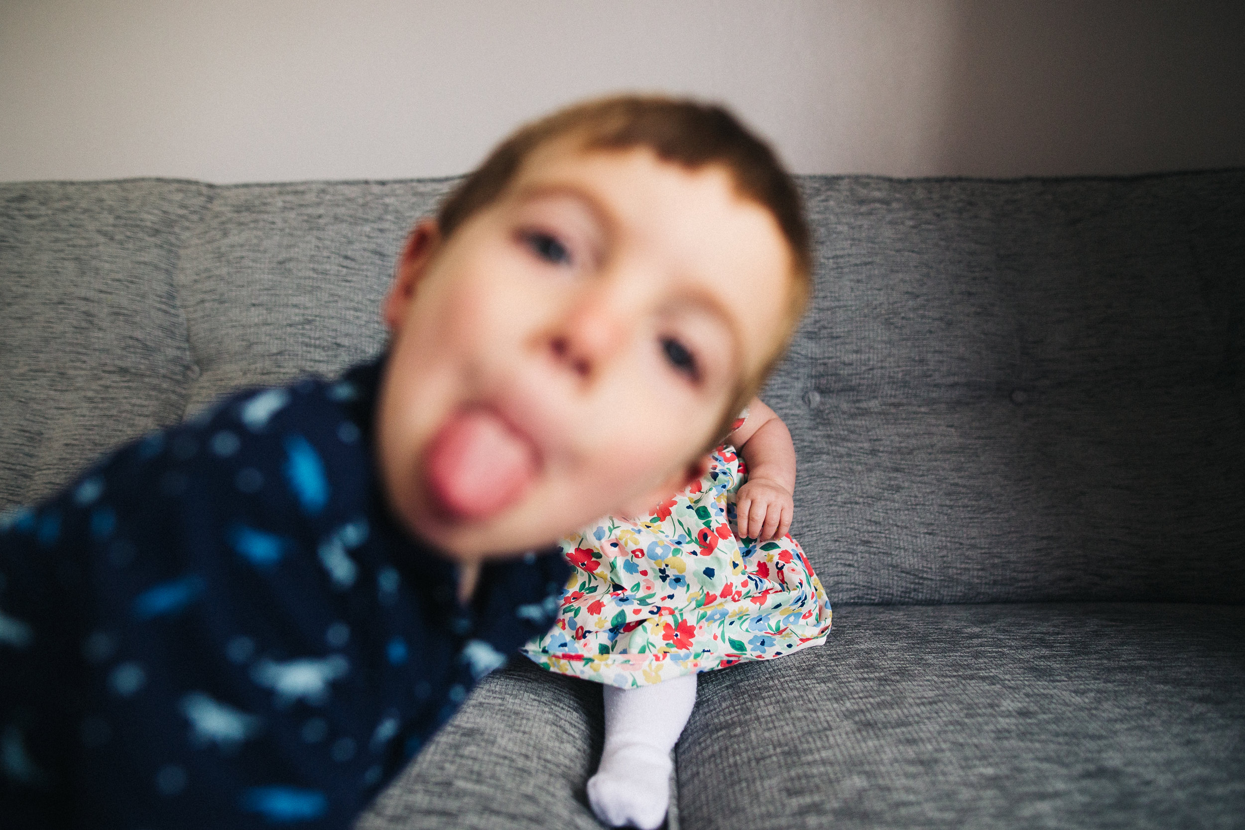 a boy photobombs a photo of his baby sister/ creative relaxed family photography teesside middlesbrough stockton north east