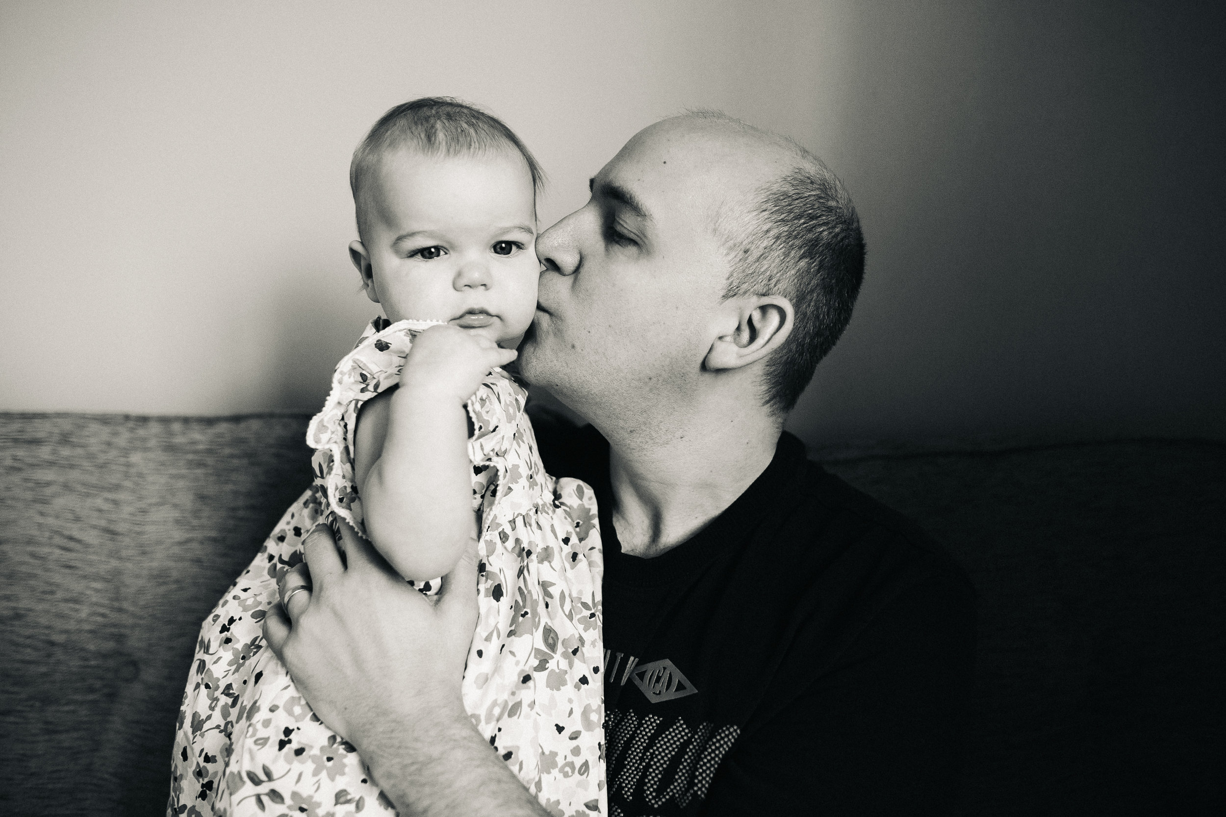 a dad kisses his daughter. creative relaxed family photography teesside middlesbrough stockton north east