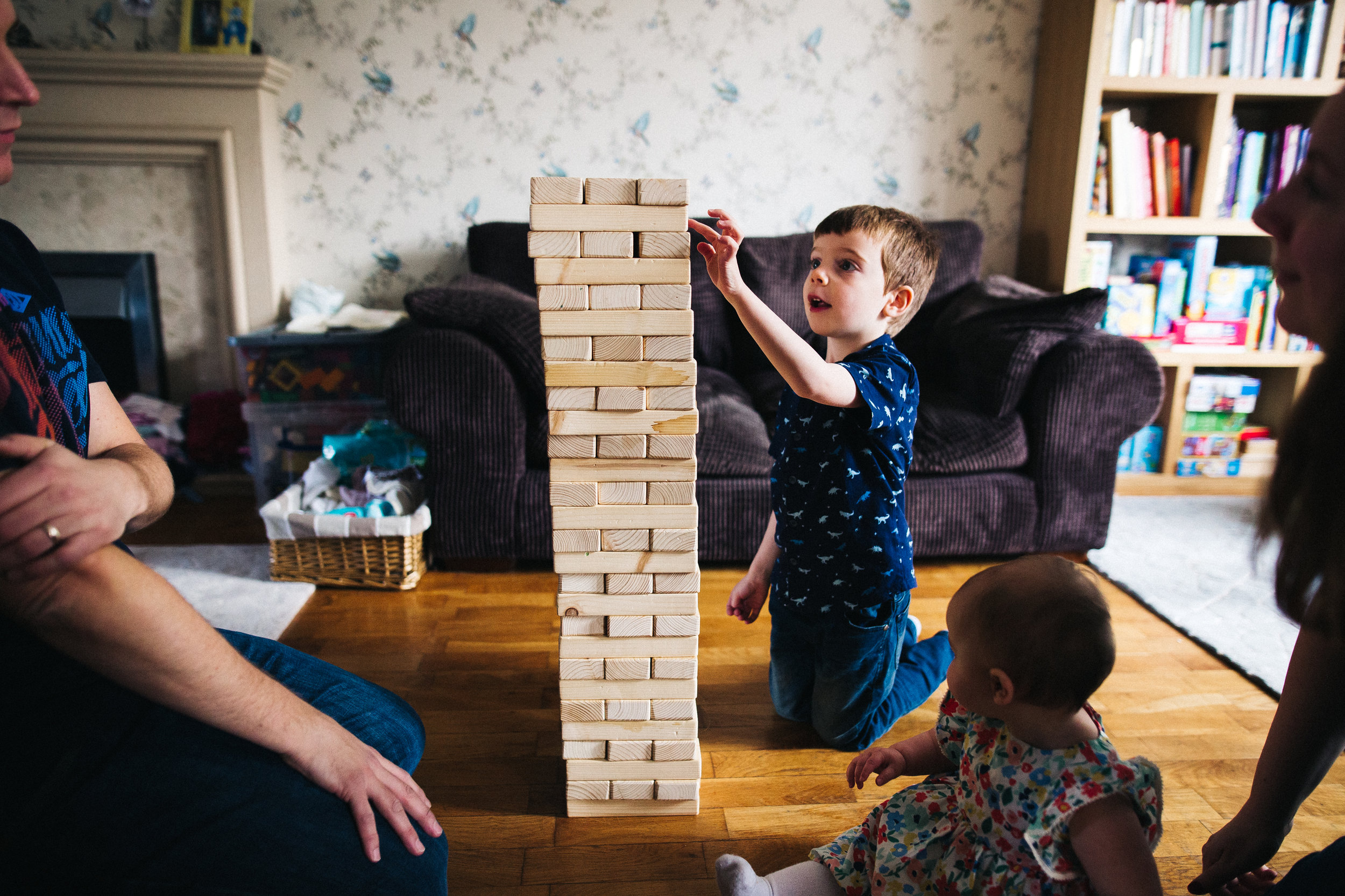 a boy plays with a jenga tower. creative relaxed family photography teesside middlesbrough stockton north east