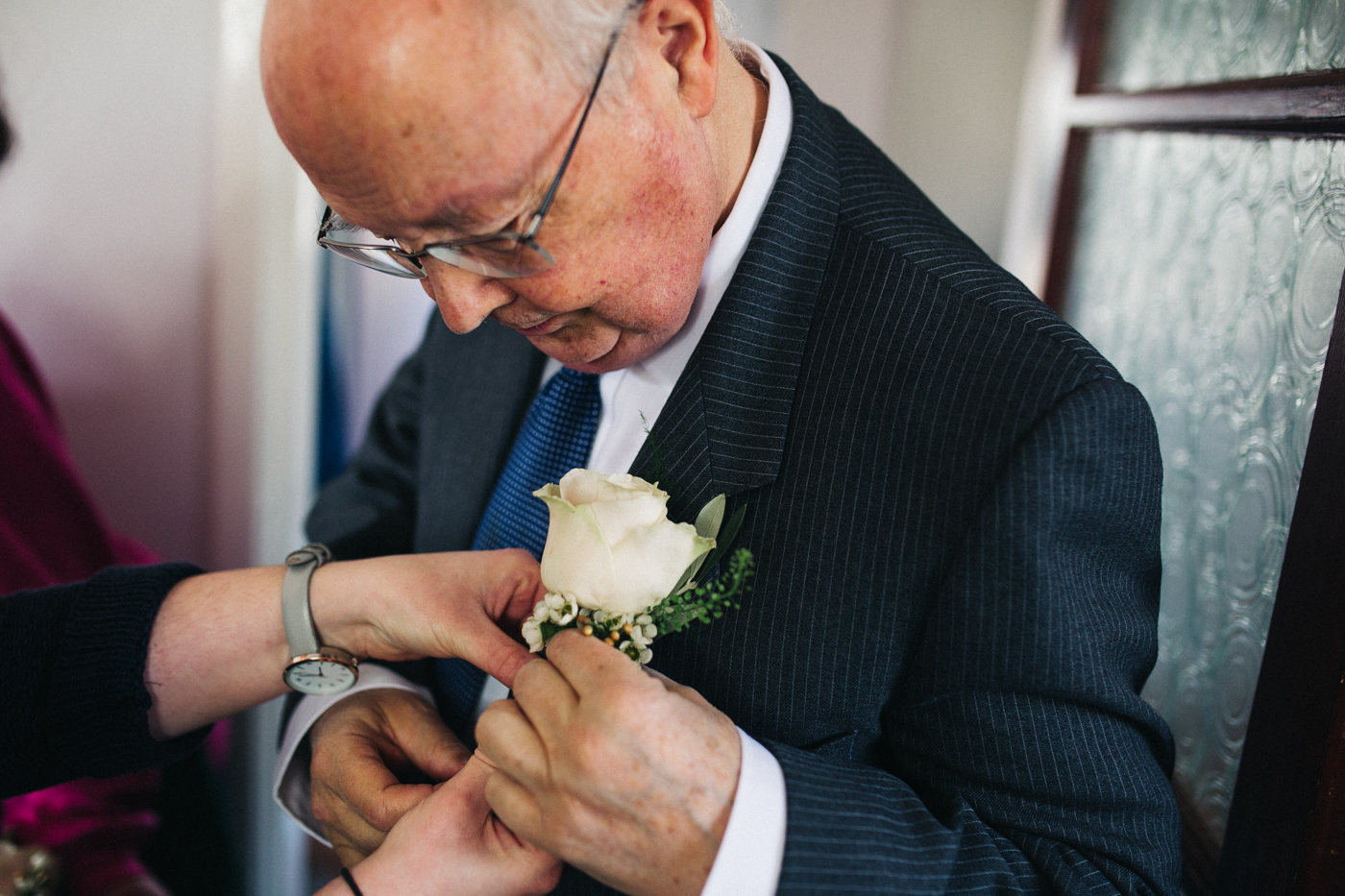 the father of the bride has his corsage fixed. ceremony at st georges hall liverpool, oh me oh my wedding reception, north west wedding photographer
