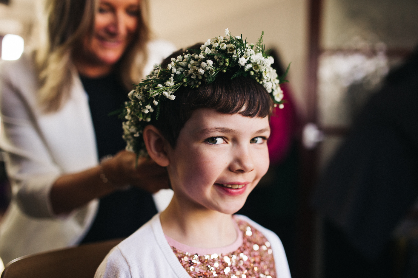 a flower girl has her flower crown put on. ceremony at st georges hall liverpool, oh me oh my wedding reception, north west wedding photographer