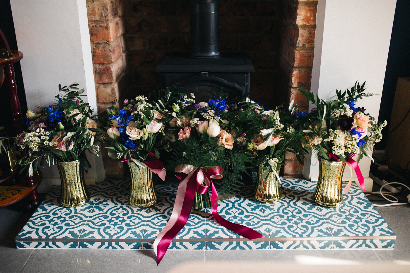 colourful wildflower bouquets on the fireplace. ceremony at st georges hall liverpool, oh me oh my wedding reception, north west wedding photographer