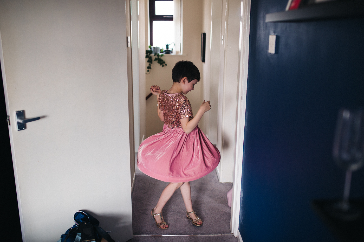 a flower girl twirls. ceremony at st georges hall liverpool, oh me oh my wedding reception, north west wedding photographer