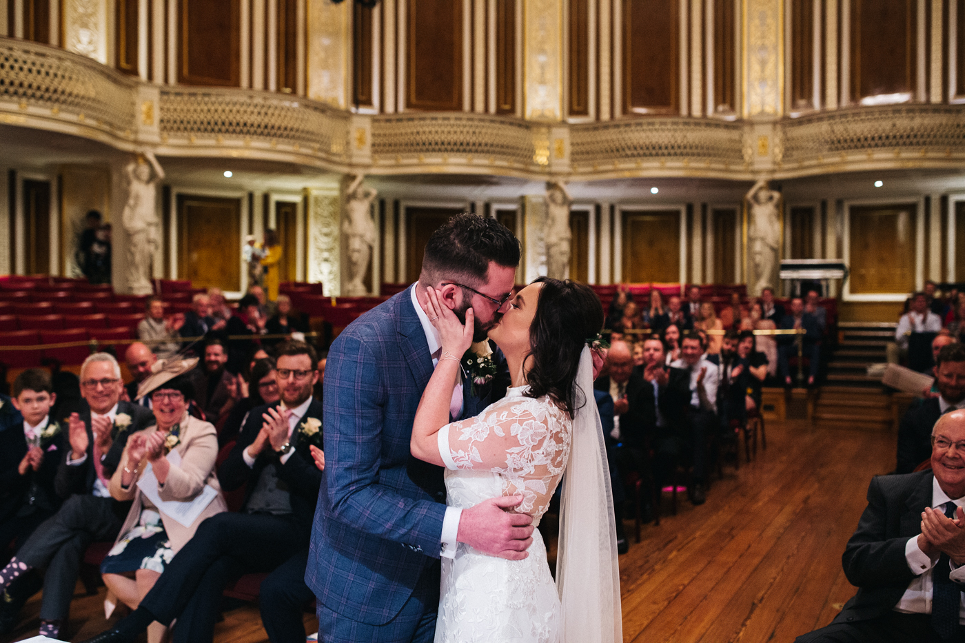 the bride and groom kiss during the ceremony. ceremony at st georges hall liverpool, oh me oh my wedding reception, north west wedding photographer