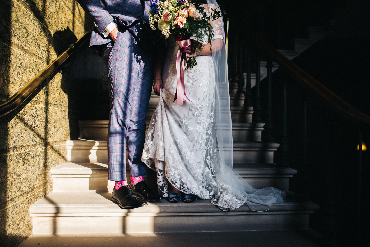 the bride and groom from the waist down shoting bouquet, bottom halves and shoes. ceremony at st georges hall liverpool, oh me oh my wedding reception, north west wedding photographer