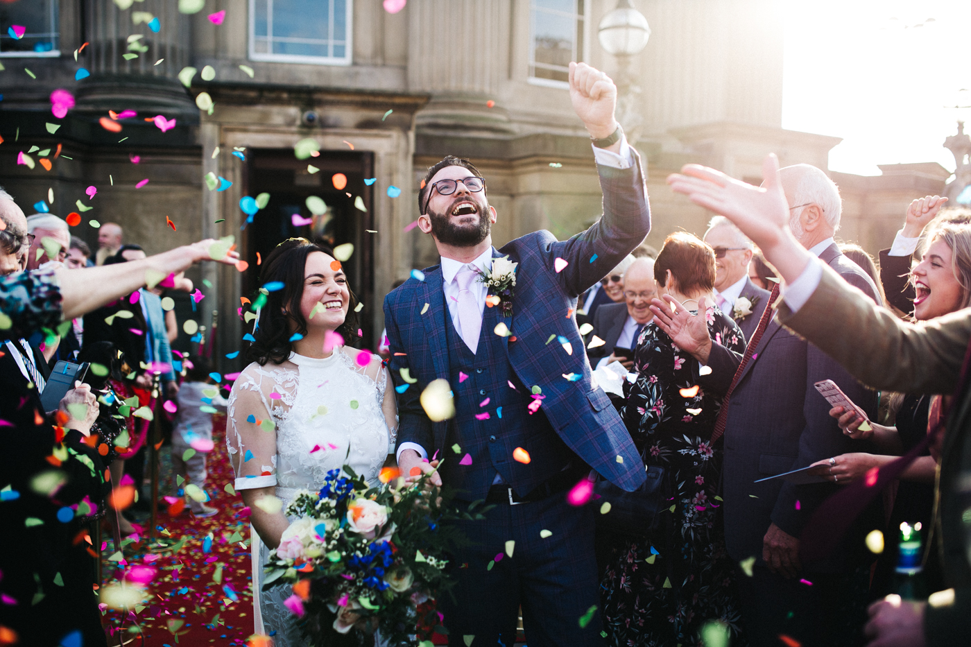 the groom punches the air during a confetti shot. ceremony at st georges hall liverpool, oh me oh my wedding reception, north west wedding photographer