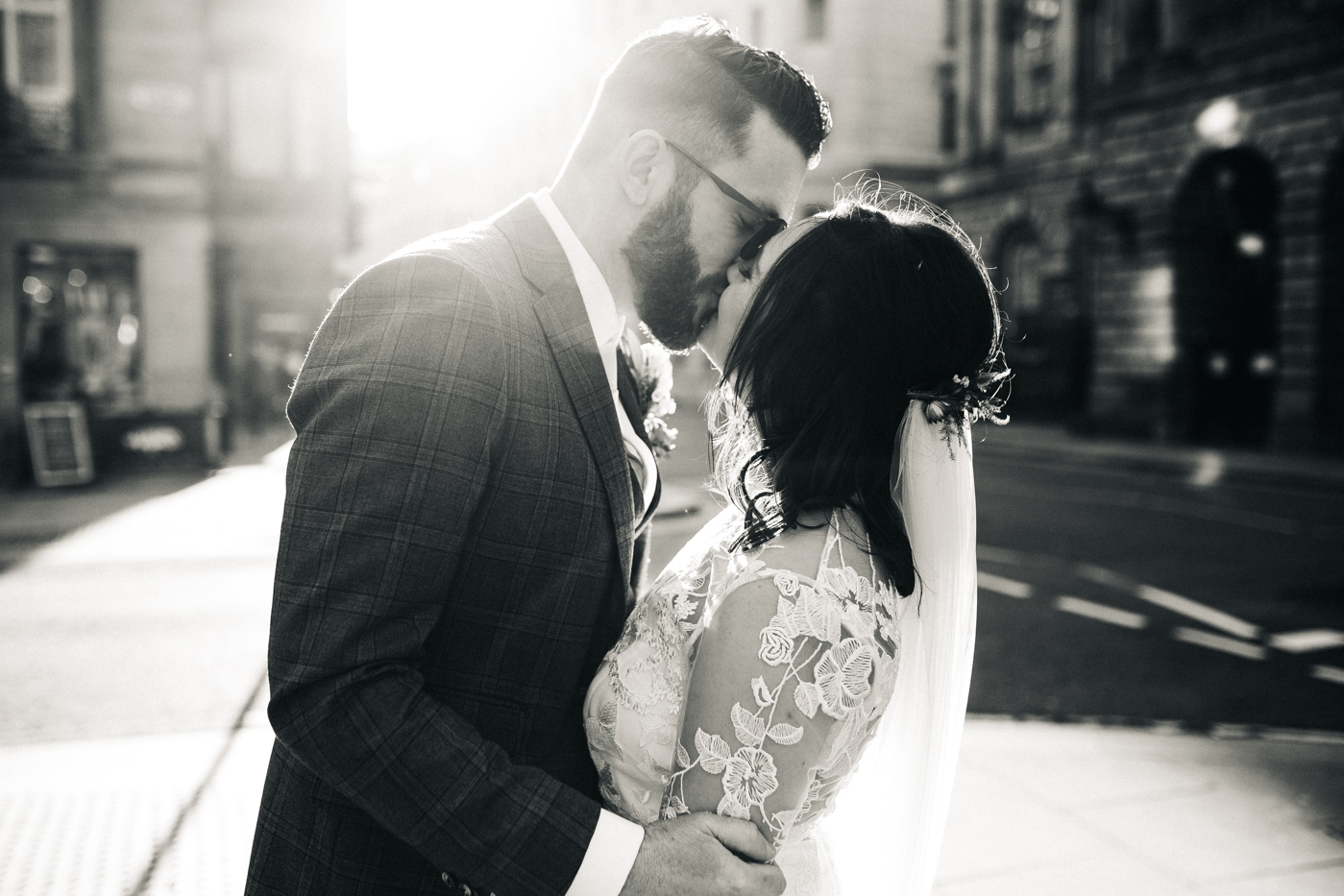 a black and white shot of the bride and groom kissing. ceremony at st georges hall liverpool, oh me oh my wedding reception, north west wedding photographer
