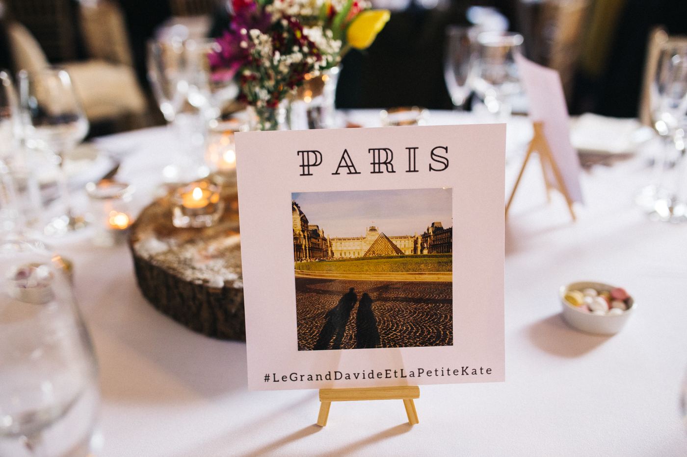 a table name with a photo and label of 'paris'. ceremony at st georges hall liverpool, oh me oh my wedding reception, north west wedding photographer