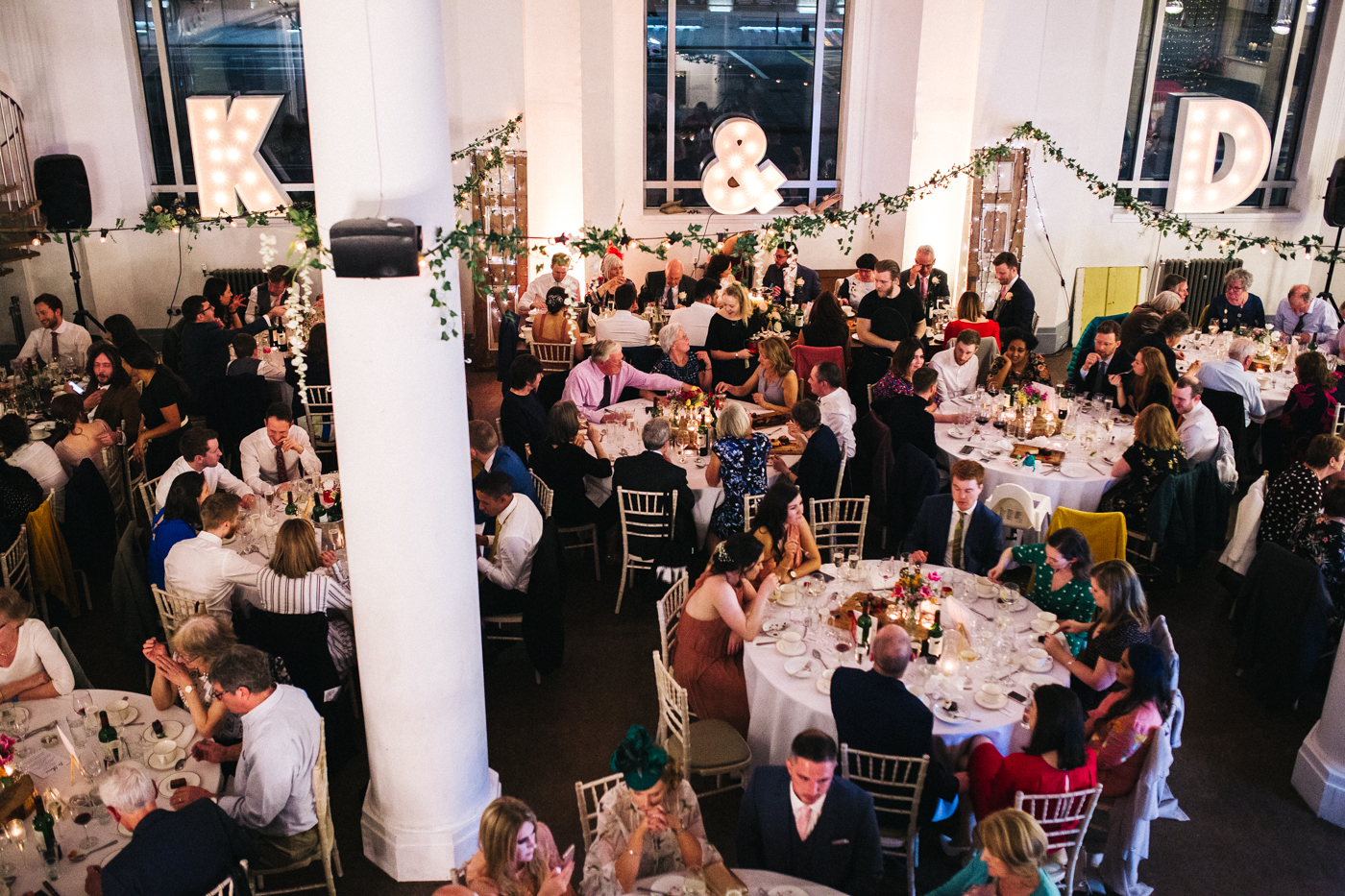 a wide shot of the meal room with carnival lighting and neon letters. ceremony at st georges hall liverpool, oh me oh my wedding reception, north west wedding photographer