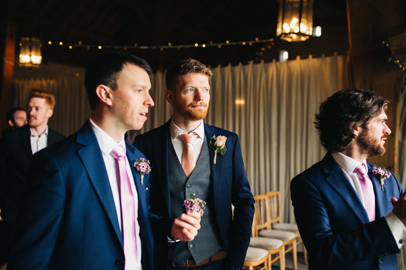 the groom and groomsmen stand together. spring barn wedding at east riddlesden hall keighley west yorkshire wedding photographer