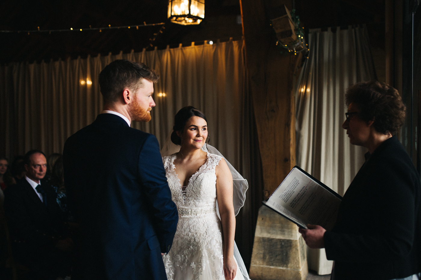 the bride and groom stand together during the ceremony. spring barn wedding at east riddlesden hall keighley west yorkshire wedding photographer
