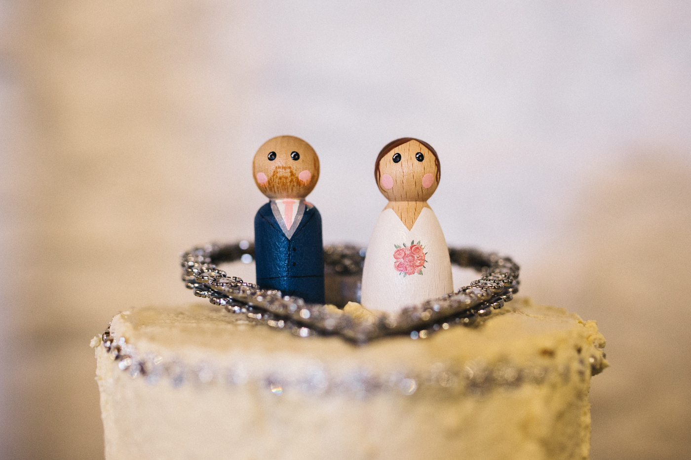 wooden peg doll wedding cake toppers. spring barn wedding at east riddlesden hall keighley west yorkshire wedding photographer
