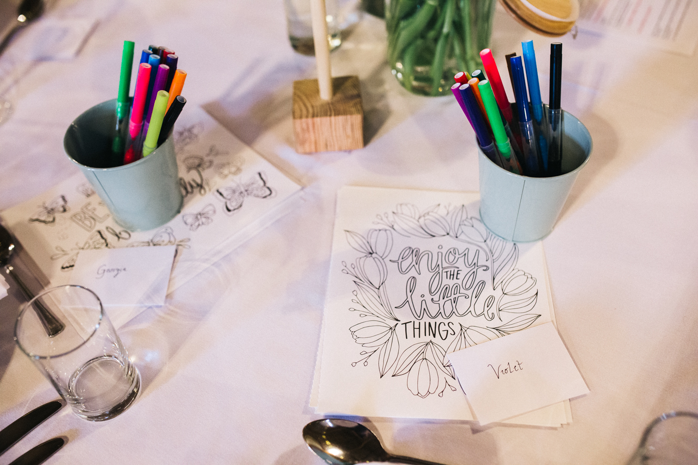 kids activities on the wedding tables. spring barn wedding at east riddlesden hall keighley west yorkshire wedding photographer