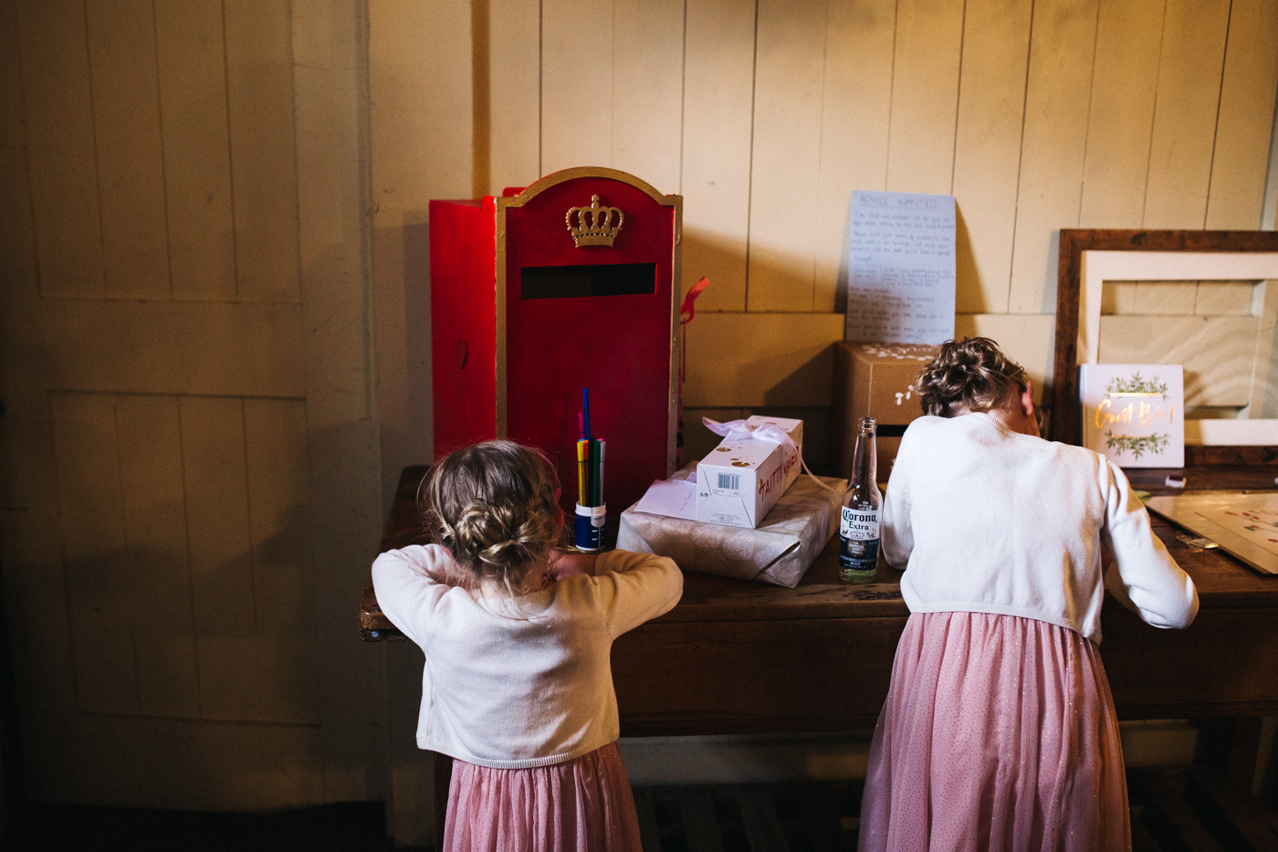 flower girls stand at the guest book table. spring barn wedding at east riddlesden hall keighley west yorkshire wedding photographer